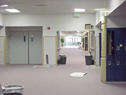 Columbine High School east entry, badly damaged by bullets