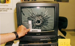 School television, destroyed by gunfire